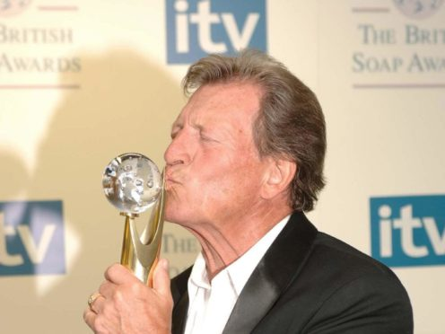 Coronation Street's Johnny Briggs with his Lifetime Achievement award (Fiona Hanson/PA)