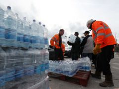 Supplies of bottled water were brought in (Jonathan Brady/PA)