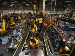 Car factory workers on the production line (Owen Humphreys/PA)