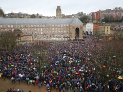 Thousands of people braved the rain to attend the protest (Aaron Chown/PA)
