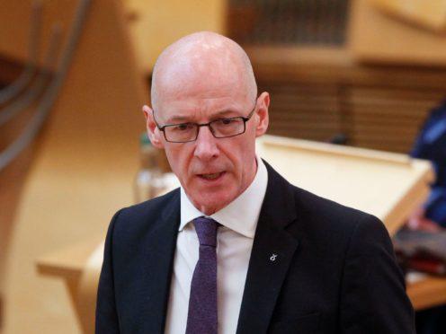 John Swinney said progress to close the attainment gap was made harder by the pandemic (Scottish Parliament/PA)