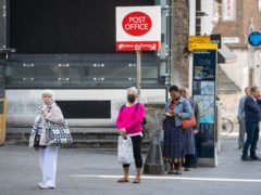 A Post Office queue in May 2020. The amount of cash deposited by businesses using Post Office branches plunged by 40% in January compared with a year earlier (Dominic Lipinski/PA)