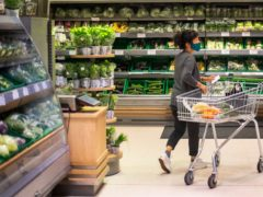 A shopper wearing a face mask in a supermarket in East London (Victoria Jones/PA)