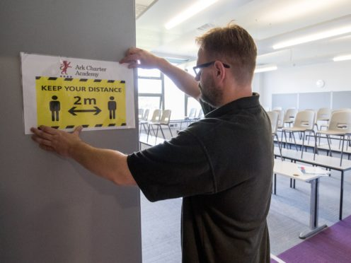 A social distancing sign is put up in a classroom at Ark Charter Academy in Portsmouth (Andrew Matthews/PA)