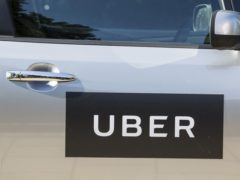 The logo of Uber on a car door. Supreme Court justices are set to decide whether Uber drivers should be classed as workers (Laura Dale/PA)