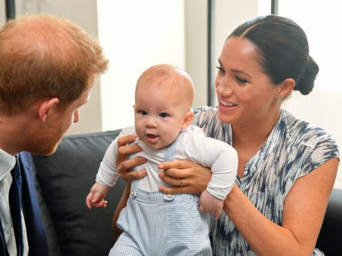 The Duke and Duchess of Sussex holding their son Archie (Toby Melville/PA)