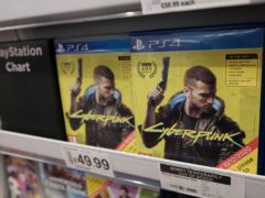 Physical copies of the PlayStation 4 video game Cyberpunk 2077 for sale in a supermarket in London (PA)