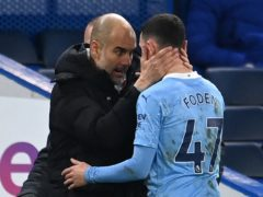 Pep Guardiola (left) has said he will not change the way he manages rising star Phil Foden (Andy Rain/PA)