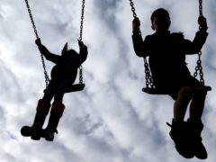 Adults are not allowed to socialise if they take their children to a playground (Gareth Fuller/PA)