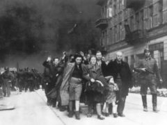 A group of Polish Jews are led away for deportation by German SS soldiers (AP)