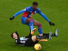 Wilfried Zaha, top, is a key absence for Crystal Palace (Stu Forster/PA)