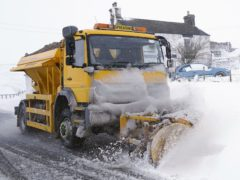 A snow plough making its way along a snow covered road in the village of Harwood in Teesdale, Durham (Owen Humphreys/PA)