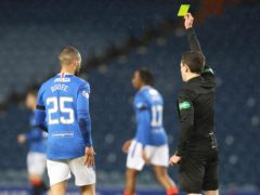 Referee David Munro (right) shows a yellow card to Rangers' Kemar Roofe for a late challenge during their Scottish Premiership clash (Jeff Holmes/PA)