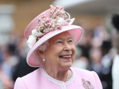 Queen Elizabeth II meeting guests during a Royal Garden Party at Buckingham Palace in London (PA Wire)