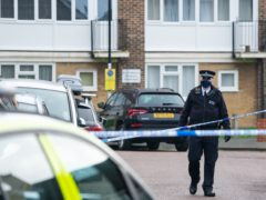 Police at the scene of a fatal stabbing at flats on Wisbeach Road in Croydon (Dominic Lipinski/PA)