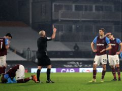Referee Mike Dean shows West Ham's Tomas Soucek a red card (Adam Davy/PA)