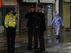 Police at the scene of a stabbing incident on Willesden Lane, in Kilburn (Dominic Lipinski/PA)