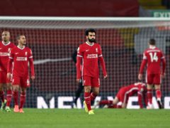 Liverpool's title defence appears to be over after defeat to Manchester City (Laurence Griffiths/PA)