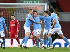 Phil Foden celebrates scoring for Manchester City at Liverpool on Sunday (Laurence Griffiths/PA)