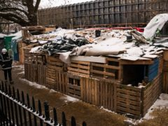 Snow covers the top of a wooden structure at the site of the HS2 Rebellion encampment in Euston Square Gardens (Aaron Chown/PA)