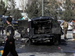 Afghan security personnel inspect the site of a deadly bomb attack in Kabul (AP)