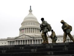 Members of the National Guard patrol the area outside of the US Capitol (Jose Luis Magana/AP)