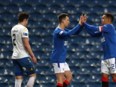 Rangers' Ryan Jack (centre) greets James Tavernier (right) after the final whistle at Ibrox on Saturday (Andrew Milligan/PA)