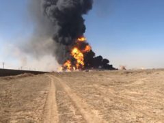 Smoke rises from fuel tankers at the Islam Qala border with Iran (AP)
