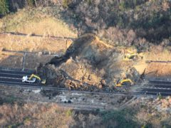 A portion of a highway is blocked by a landslide after an earthquake hit Fukushima prefecture in north-eastern Japan (Hironori Asakawa/Kyodo News/AP)