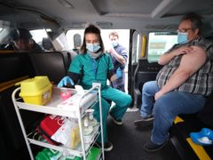 Medical student Leona Leipold after giving Bradley Winfield the Oxford/AstraZeneca Covid-19 vaccination in the back of a taxi (Yui Mok/PA)