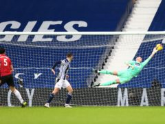 West Brom goalkeeper Sam Johnstone (right) produces a brilliant late save to earn his side a point (Michael Steele/PA).