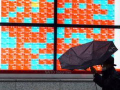 The Japanese economy grew at an annual rate of 12.7% in October-December (Eugene Hoshiko/AP)