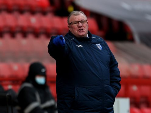 Steve Evans was unhappy after Gillingham's defeat at AFC Wimbledon (Steven Paston/PA)