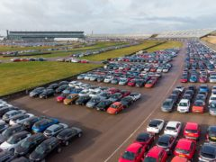 Used cars parked bumper to bumper as far as the eye can see at the former Rockingham Motor Speedway circuit, which is now used for vehicle storage (Joe Giddens/PA)