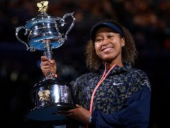 Naomi Osaka holds the Daphne Akhurst Memorial Cup aloft (Andy Brownbill/AP)