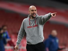 Pep Guardiola has sarcastically claimed Manchester City's success is solely down to money (Shaun Botterill/PA)