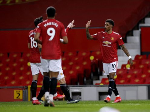 Marcus Rashford, right, opened the scoring for Manchester United against Newcastle (Phil Noble/PA)