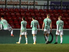 Celtic players trudge off after another defeat (Jeff Holmes/PA)