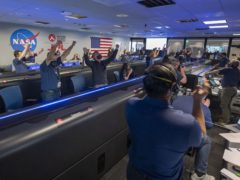 Nasa scientists cheering the conformation that the Mars Perseverance rover touched down on the red planet (Nasa)
