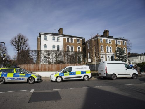 Police vehicles outside a property on Castlebar Road, Ealing, west London, where a woman in her 40s was found dead on Monday (Aaron Chown/PA)