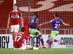 Famara Diedhiou, centre, celebrates his second goal with fellow scorer Nahki Wells (Tim Goode/PA)