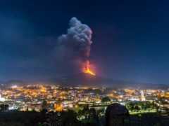 Flames and smoke billowing from Mount Etna (Salvatore Allegra/AP)