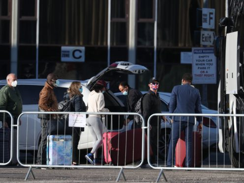 Guests leave the Radisson Blu Edwardian hotel, near Heathrow Airport, after completing their 10-day quarantine (Andrew Matthews/PA)