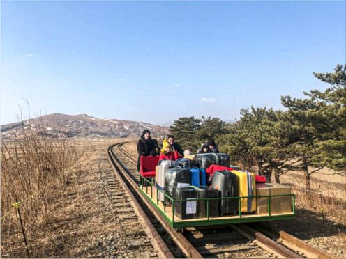 A group of Russian diplomats and their families travel on the rail trolley (Russian Foreign Ministry Press Service via AP)
