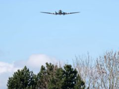 A Dakota performs a fly-past at the funeral (Joe Giddens/PA)