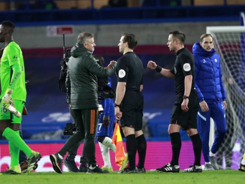 Manchester United manager Ole Gunnar Solskjaer, left, fistbumps referee Stuart Attwell, right, after the match (Ian Walton/PA)