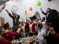 Ultra-Orthodox Jews celebrate during the Jewish holiday of Purim (Oded Balilty/AP)