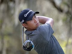 Collin Morikawa watches his tee shot on the ninth hole during the final round of the Workday Championship golf tournament Sunday, Feb. 28, 2021, in Bradenton, Fla. (AP Photo/Phelan M. Ebenhack)