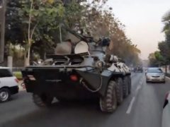 Two armoured personnel carriers are seen traversing on a road in Yangon, Myanmar on Sunday (DVB/AP)