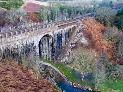 The rail bridge near Stonehaven has been repaired after part of the masonry fell away (Network Rail/PA)